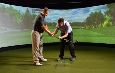 Demonstrating golf club grip